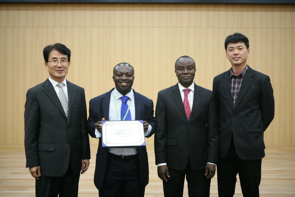 a certificate of excellence on Mr. Michael Kwabena Osei Ghana awarded by Korean government